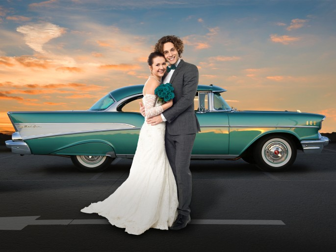 Wedding couple with 1957 Chevrolet.